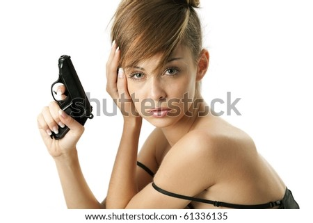 Attractive young woman with handgun over white