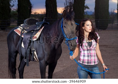 Attractive young woman with her stallion