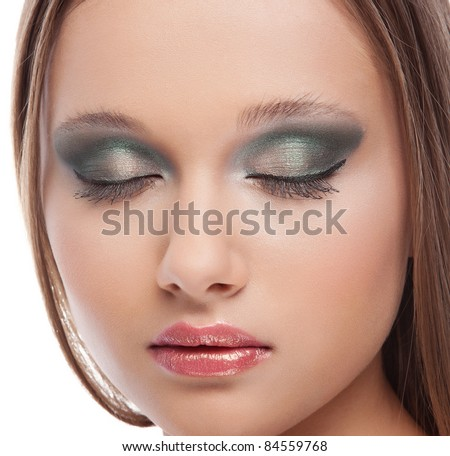 Attractive young woman with modern fashion blue green makeup of female eye on white background #84559768