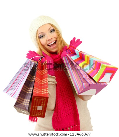 Attractive young woman woman with lot of shopping bags, isolated on white