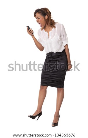 Attractive young woman yells into her cell phone isolated on white background.