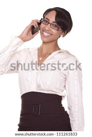 Attractive, young women with glasses flashes a perfect smile while on the phone.