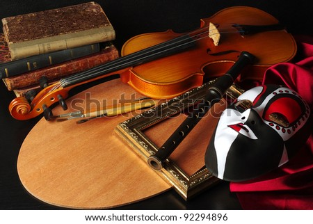 Attributes of Arts: music, painting, theater. Palette, violin,  mask, brushes, flute, frame, books, drapery