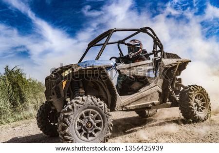 ATV adventure. Buggy extreme ride on dirt track. UTV Foto stock ©