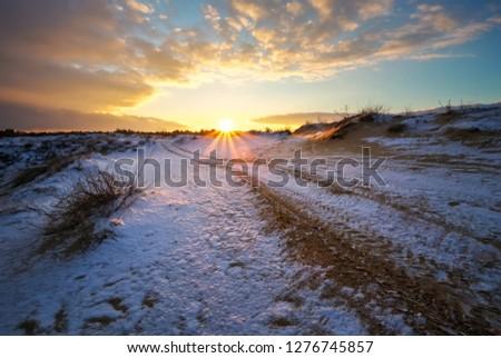 ATV auto sport track at winter. Wheel sandy tracks on snow #1276745857
