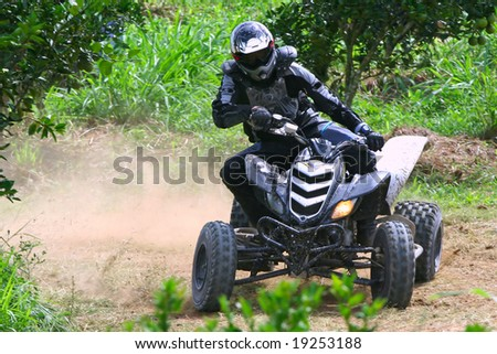 atv racing on dirt track