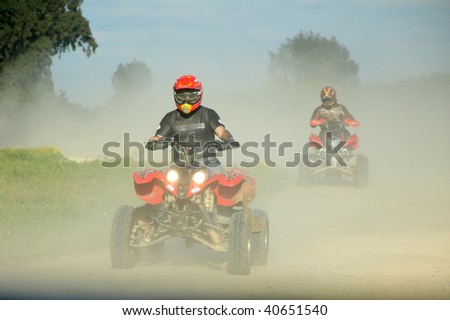 ATV racing outdoors. 2 drives on ATV