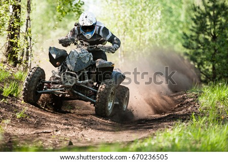 ATV rider creates a large cloud of dust and debris on sunny day Stock photo ©