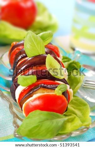 aubergine,mozzarella and tomato slices with basil