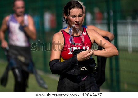 AUCH, FRANCE - SEPTEMBER 8: an unidentified female runner in the transition area after the swim race, Auch Triathlon, on September 8, 2012 in Auch, France.