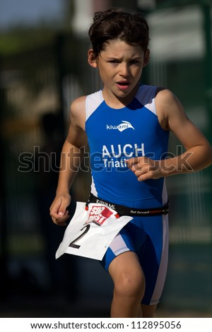 AUCH, FRANCE - SEPTEMBER 8: an unidentified young runner, Auch Triathlon, on September 8, 2012 in Auch, France.