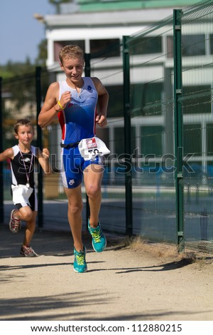 AUCH, FRANCE - SEPTEMBER 8: an unidentified young triathlete, Auch Triathlon, on September 8, 2012 in Auch, France.