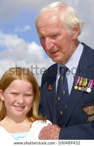 AUCKLAND - APRIL 25: A World War 2 veteran stands with his unidentified grand daughter following the annual ANZAC Day remembrance service, on April 25, 2007 in Auckland, New Zealand.