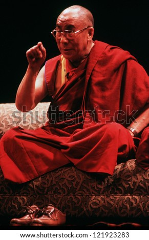 AUCKLAND-APRIL 10:14th Dalai Lama of Tibet is giving a speech in Auckland New Zealand in April 10 2003.He has lived in exile in India since the Chinese Army crushed an uprising in his homeland in 1959 - stock photo