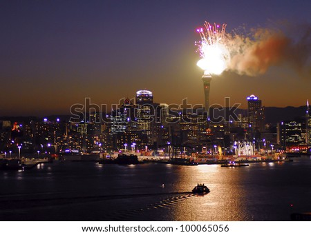 Auckland city skyline with fireworks exploding from the landmark Skytower building