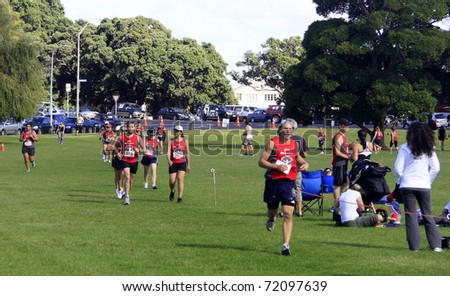 AUCKLAND- Feb. 27: Participants in the Cathay Pacific  Auckland marathon run sprint to the finish line on Sunday Feb. 27,2011 at  Orakei, Auckland, New Zealand