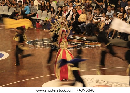 AUCKLAND - JAN 16: Filipino Catholic devotees dance and perform in the Annual Feast of the Child Jesus  Sinulog Santo Nino at the Northshore Event Center in Auckland, New Zealand on January 16, 2011
