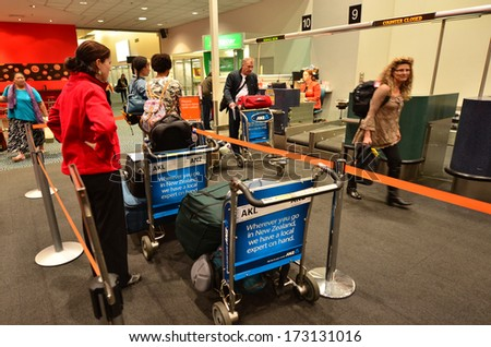 AUCKLAND - JAN 12:Passengers waiting to check-in at Auckland Airport on Jan 12 2014.60% of people check-in through the airline�¢??s main counter, which takes an average of 19 minutes.