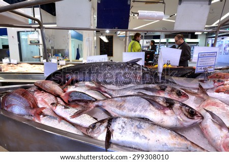 AUCKLAND - JULY 08 2015:Shoppers in Auckland Fish Market, Auckland New Zealand.The Fish Market building, hosts fresh seafood retailers, a boutique food market, restaurants and Auckland Seafood School.