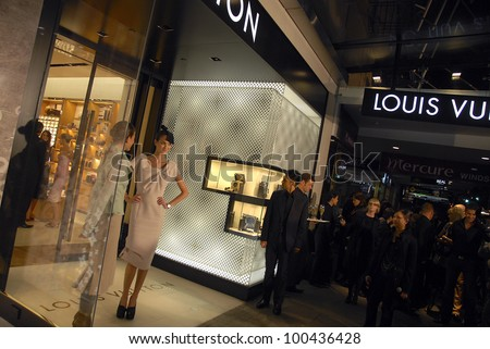 AUCKLAND - JUNE 5: Two models pose for photographers on opening night of Louis Vuitton's new flagship store in Queen Street on June 5, 2008 in Auckland, New Zealand.
