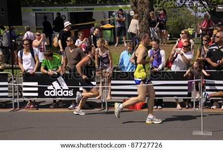 AUCKLAND- OCT. 30: Unidentified participants in the Adidas Auckland marathon run sprint to the finish line on Sunday Oct. 30,2011 in  Auckland, New Zealand