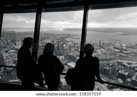 AUCKLAND - OCT 08: Visitors at the Sky Tower observation deck on Oct 08 2013.It's 328 metres (1,076ft) tall and it the tallest free-standing structure in the Southern Hemisphere. (BW) #158357159