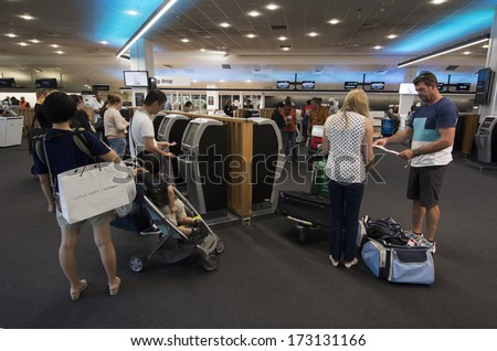 AUCKLNAD - DEC 31:Passengers self checks in at Auckland airport on Dec 31 2013.The service is promoted by airlines to reduces the time a passenger would normally spend at an airport check-in counter.
