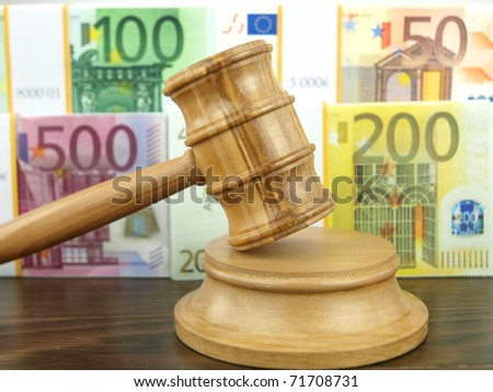 Auction gavel and money euro