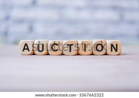 AUCTION word written on wood block