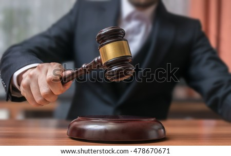 Auctioneer is hitting with gavel. Auction and Justice concept.