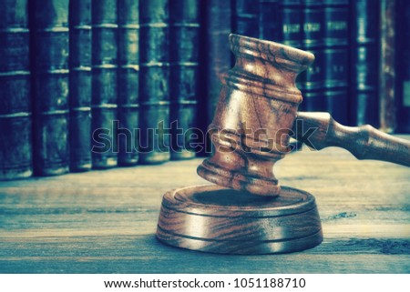 Auctioneers Or Judges Gavel Or Hammer On The Wooden Judge Or Auctioneer Table. Law, Auction Bidding, Judicial Practice Or Judicial Hearing Concept, Close Up. Front View. Different Effects