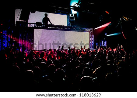 Audience Crowd Silhouette Dancing to DJ Pete Tong at Cream Nightclub Party. Nightlife Lazer Show Hands In Air