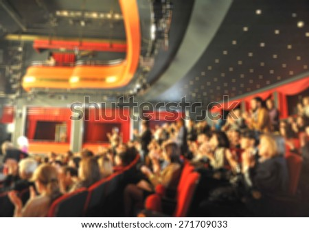 Audience in a theater, on a concert  and applauding