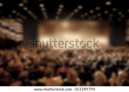 Audience in a theater, on a concert and applauding blurred #353289794