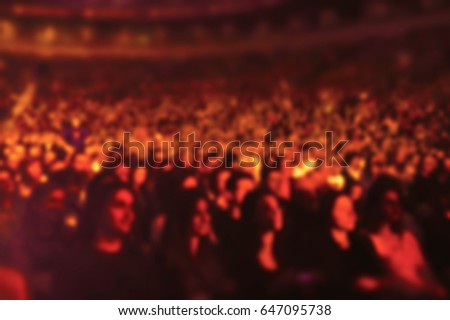 Audience in a theater, on a concert and applauding blurred