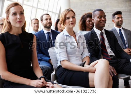 Audience Listening To Speaker At Business Conference