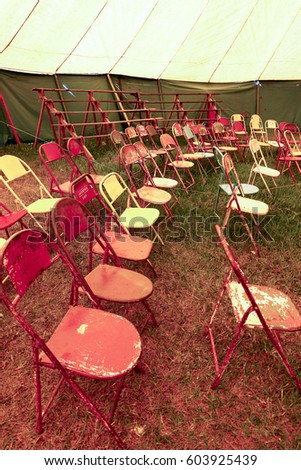 Audience of traveling circus with empty chairs in the countryside of the Brazil