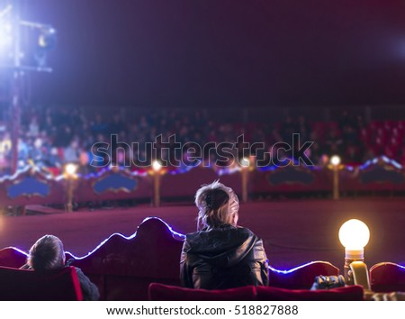 Audience on circus. Mom and child watching circus. #518827888