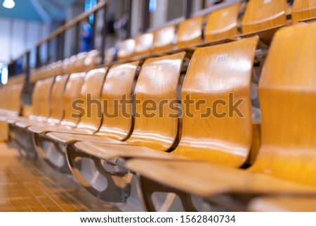 Audience seats lined with wooden chairs