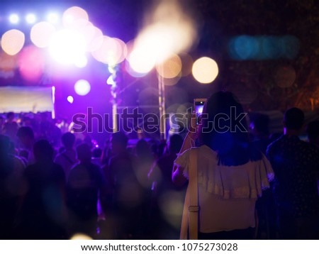 Audience take a photo on mobile phone at a free night concert music festival. #1075273028