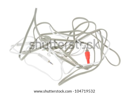 Audio and video cables isolated on white