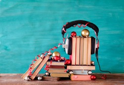 audio books as christmas gift,x-mas present, books and vintage headphones,christmas decoaration, reading,literature,education