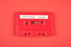 Audio cassette tape with christmas songs on a red background