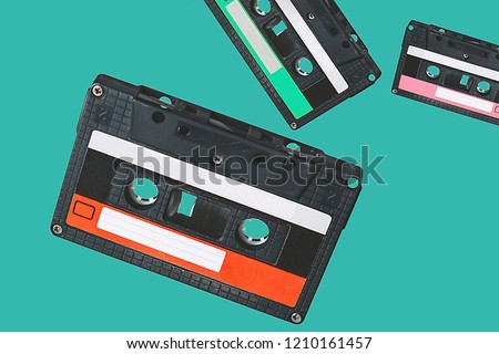 Audio cassette. Vintage audio cassette tap on colored background. Old cassette tape audio isolated. Retro poster