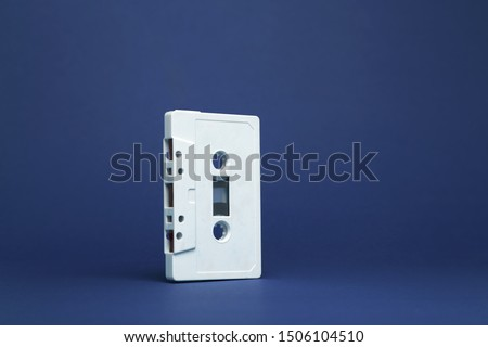 Audio cassette. Vintage white audio cassette tap on colored background. Composition of a  cassette tape audio isolated. Pattern of a audio cassette tap.