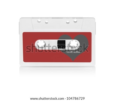 Audio cassette with love heart shape, isolated on white background.