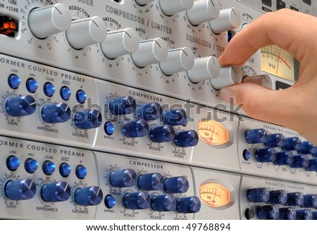 Audio engineer's hand operating studio devices for a music production