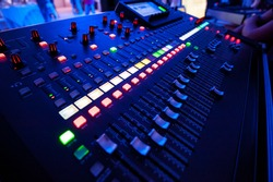 Audio mixer and microphone. Close-up of the Mixing console. mixing knobs. tilt-shift. Perspective
