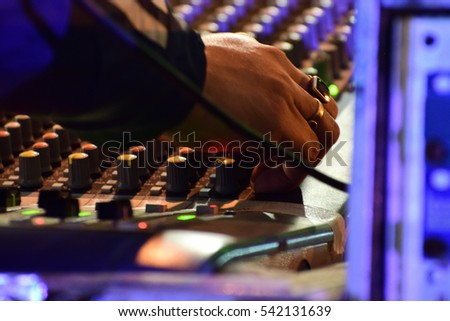 Audio mixer, music equipment in a live concert. Adjusting audio mixer #542131639