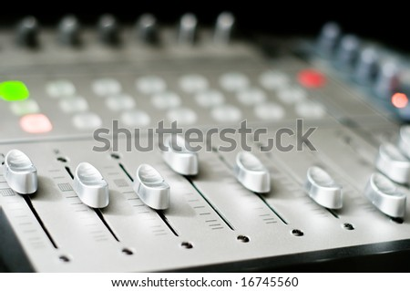 Audio mixer with copyspace created by very narrow depth of field